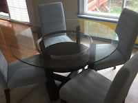 Round Glass table (wood base) with four chairs dining set Fort Belvoir, 22060