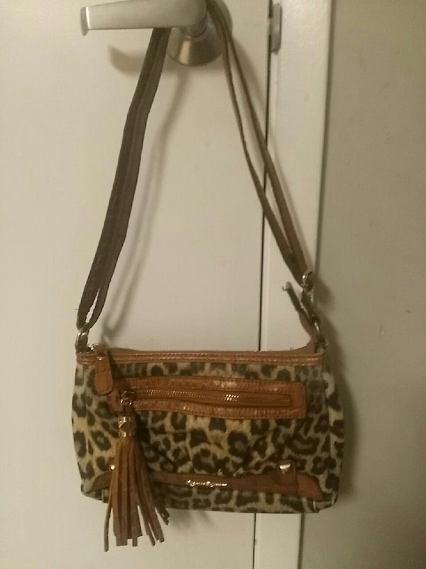 b10c416a51751f brown and black leopard print leather crossbody bag with tassel ...