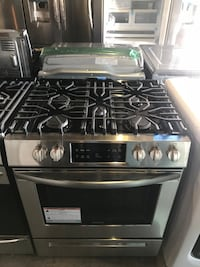 New gas stove slide in 30in Frigidaire 6 months warranty