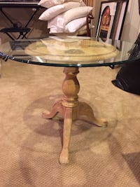 round clear glass-top table with brown wooden base Centreville, 20120
