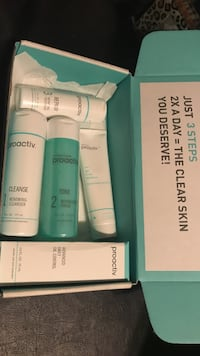White and teal proactiv 4-piece gift set box 2337 mi