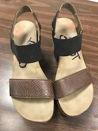 pair of beige-and-black sandals Summerdale, 36580