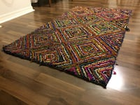 red, green, and blue knitted area rug
