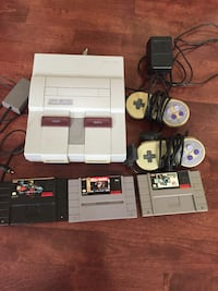 NES console with controller and game cartridges Blainville, J7B 6B6