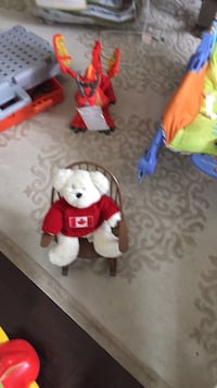 Tiny rocking chair and teddy no holds