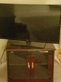 black flat screen TV with remote Fairfax, 22030