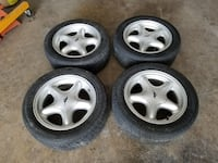 gray 5-spoke car wheel with tire set 40 mi