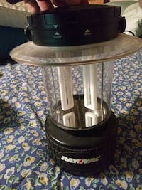 Two brand-new operated camping lanterns one large one medium
