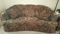 brown, red and black fabric floral sofa
