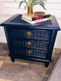 Adorable dresser/end table with lion pull handles, made of solid wood.