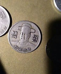 round silver-colored coin