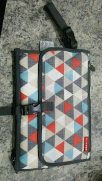 black, blue, red, and white wristlet