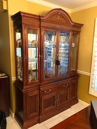 Brown wooden framed glass china cabinet null