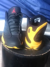 pair of black-and-yellow Air Jordan shoes Jacksonville, 32254