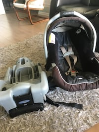 black and brown Graco carrier car seat with gray base