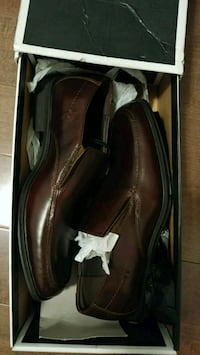 pair of brown leather dress shoes in box