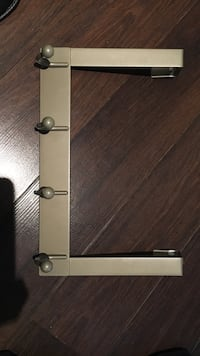 brown metal clothes wall rack