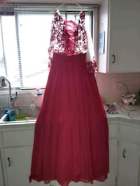 Red dress with sheer detail size 10-12. Calgary, T2K 3Y4