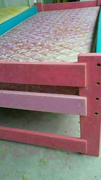 pink, blue and purple wooden bed frame