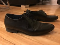 pair of black leather dress shoes Montréal, H2R 2S8