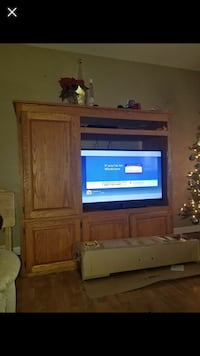 flat screen TV and brown wooden TV hutch 982 mi