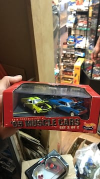 two blue and green car scale model package