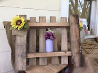 Rustic pallet shelf with sunflower accent
