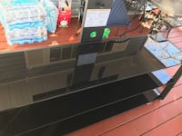 black and gray glass TV stand