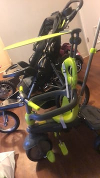 toddler's black and green bicycle with training wheels Baltimore, 21202