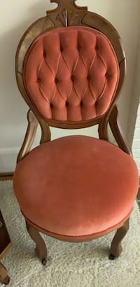 brown wooden framed red padded chair null