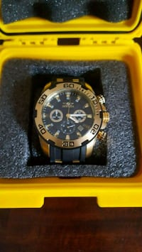 round black and gold chronograph watch with link b Surrey, V3S 2A4