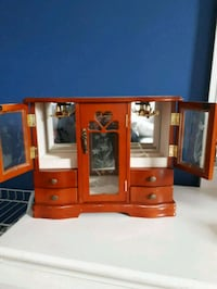 brown wooden TV hutch with flat screen television Charlemagne, J5Z 3E1