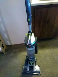 blue and green upright vacuum cleaner 2336 mi