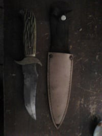 silver bladed knife with brown sheath Southaven