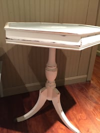 White wooden pedestal table