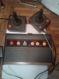 black atari console and game controllers Greeley, 80631
