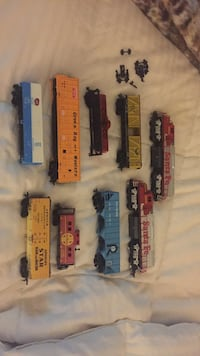 Trains some missing wheels two engines as is .9 prices and some wheels!!