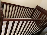 Heavy Wood baby crib in excellent condition and almost new mattress