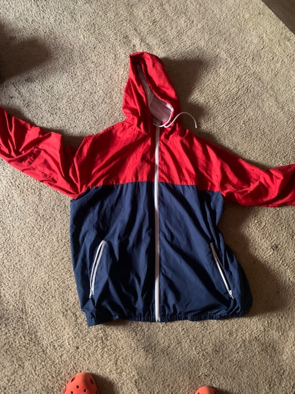 Red and blue windbreaker  3afe272c-f385-492a-b222-28a75f67c929