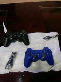 black and blue Sony PS3 controllers Alexandria, 22307