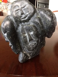 """Inuit Stone Sculpture """"Many Faces""""  Dimensions: 7"""" tall x 6"""" wide x 3"""" deep  In Excellent Condition   Retails for $3600.  Offered for only $1200. Toronto, M5P 2V5"""
