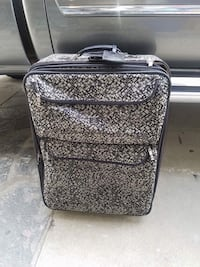gray and black rolling luggage