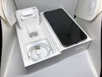 White IPhone X charger and complete accessories with box 41 km