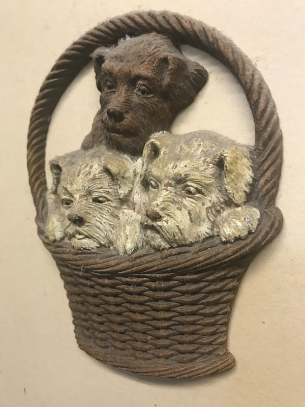 Wall decoration with 3 dogs. Little chip off bottom left of basket. Very old