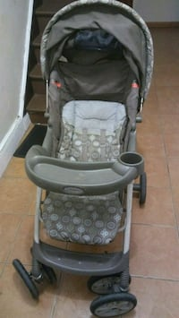 baby's gray and black stroller Queens, 11418