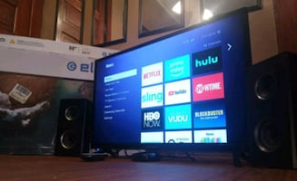 32 inch TV with Roku, speakers and wall mount