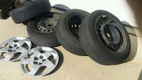 4Tires and wheels 205/55/R16 plus 2 wheelcovers  584 mi