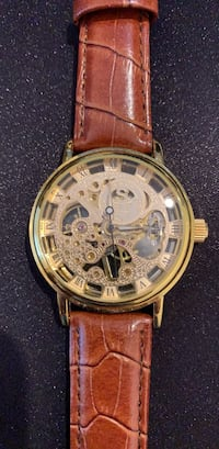 Round gold chronograph watch with brown leather strap Edmonton, T6R 2K5