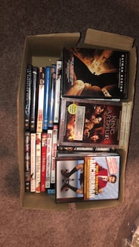 Box of DVD's - 52 Movies in the Box