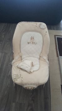 baby's brown and white bouncer Calgary